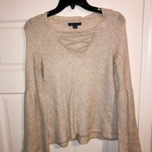 Cream sweater with flare sleeves